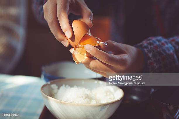 Close-Up Of Hands Holding Egg