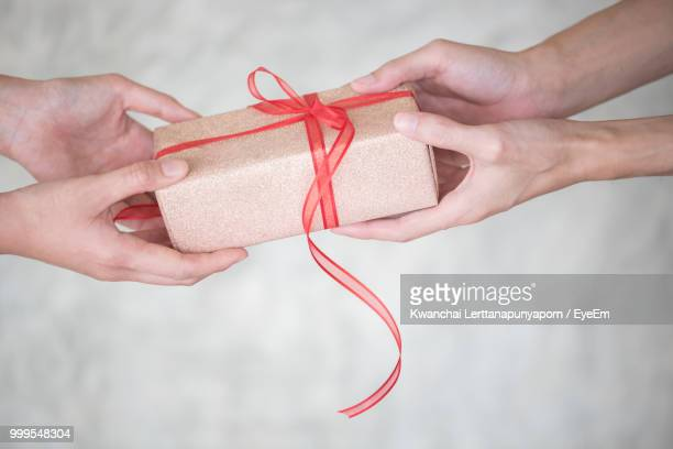 Close-Up Of Hands Holding Gift Box