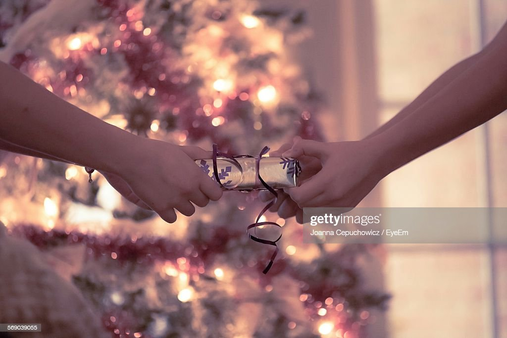 Close-Up Of Hands Holding Gift : Stock Photo