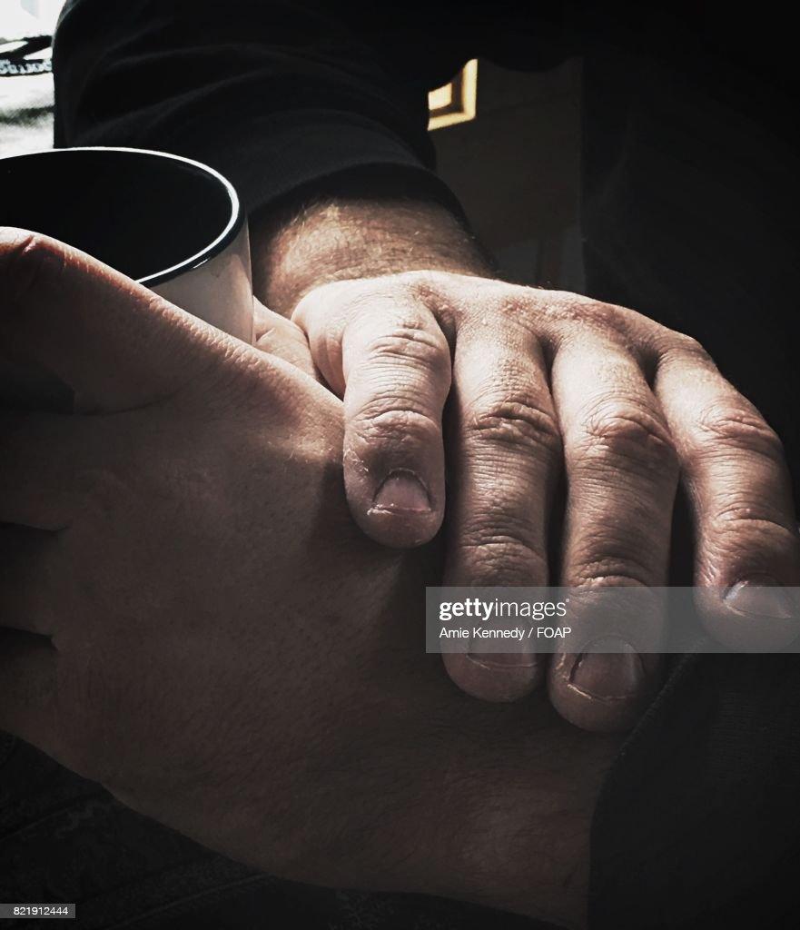 Close-up of hands holding mug : Stock Photo