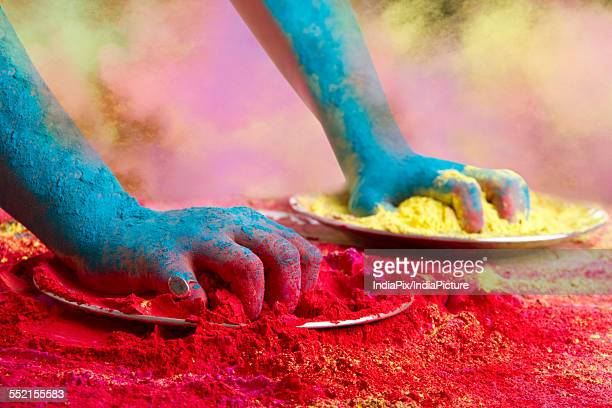 Close-up of hands holding powder paints during Holi festival