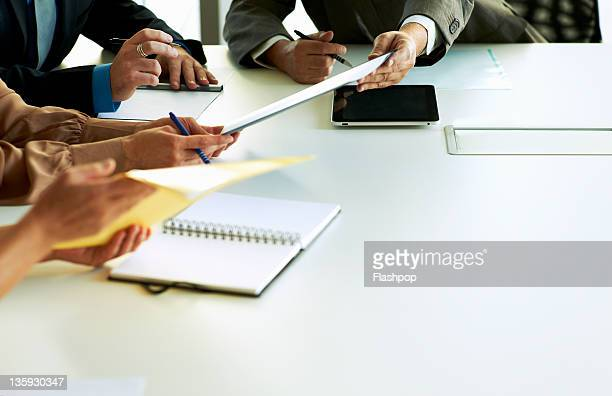 Close-up of hands in business meeting