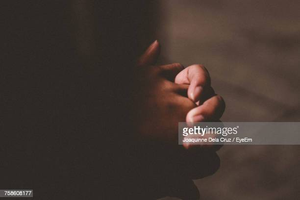 close-up of hands in prayer - grief stock pictures, royalty-free photos & images