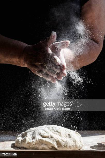 Close-Up Of Hands Making A Cake