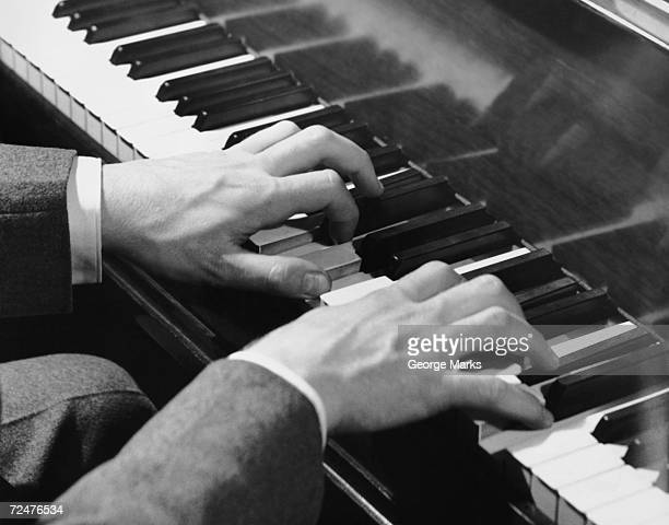 Closeup of hands on piano keys