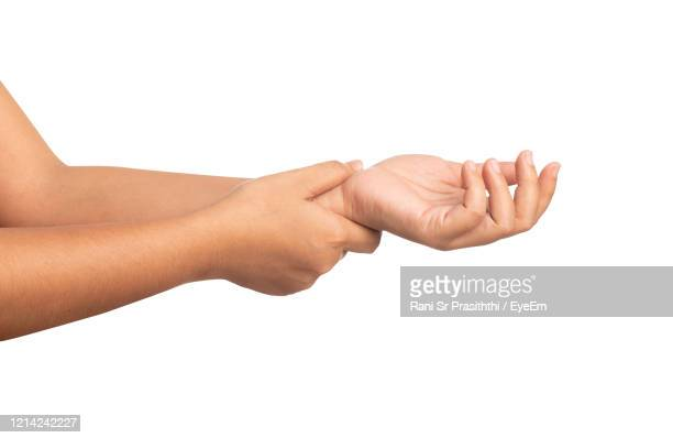 close-up of hands over white background - injured stock pictures, royalty-free photos & images