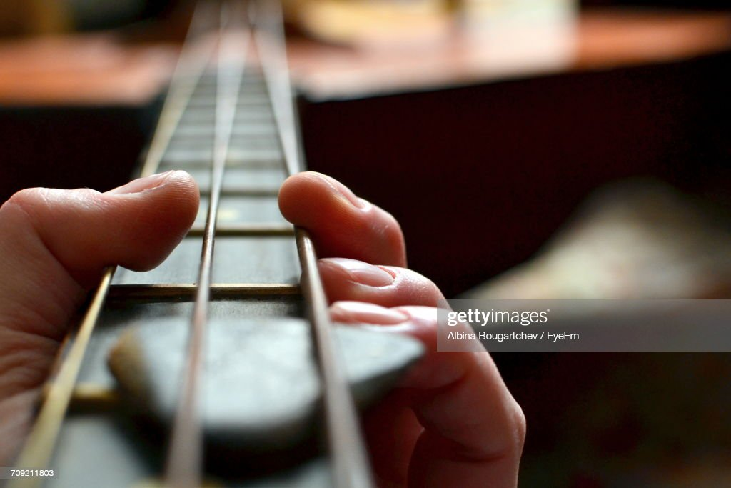 Close-Up Of Hands Playing Instrument : Stock Photo