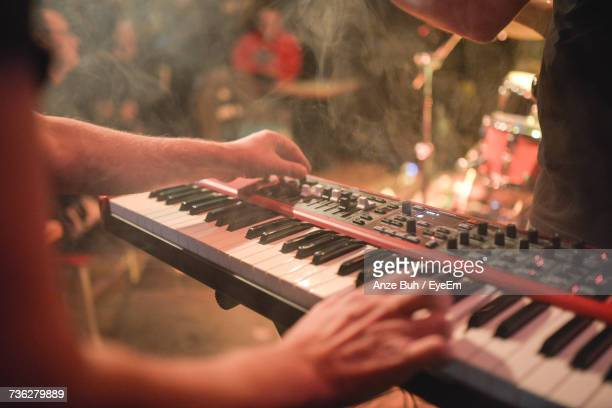 close-up of hands playing piano - keyboard instrument stock photos and pictures