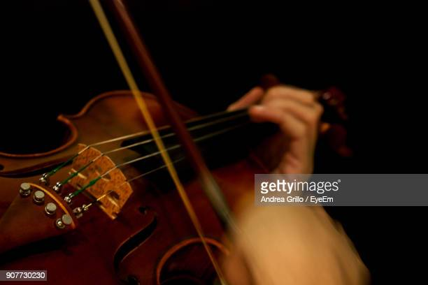 close-up of hands playing violin - classical stock pictures, royalty-free photos & images