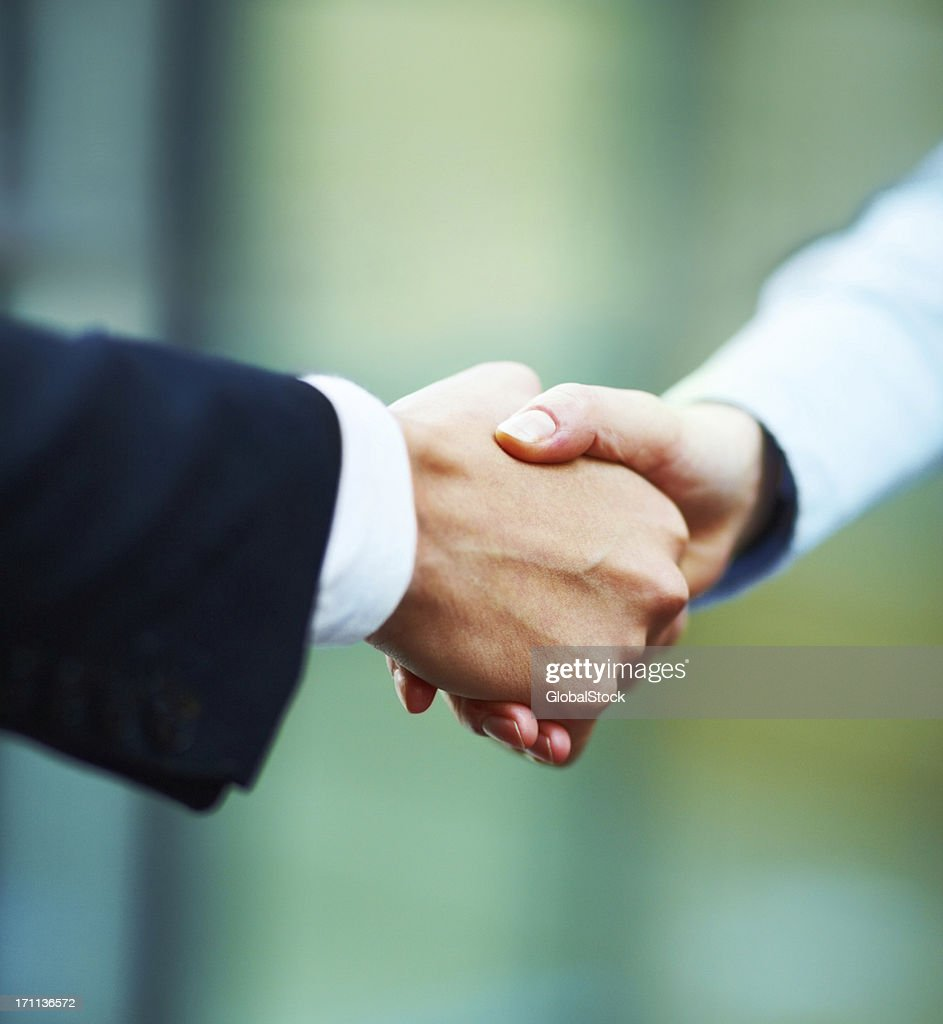 Close-up of hands shake between two business people : Stock Photo