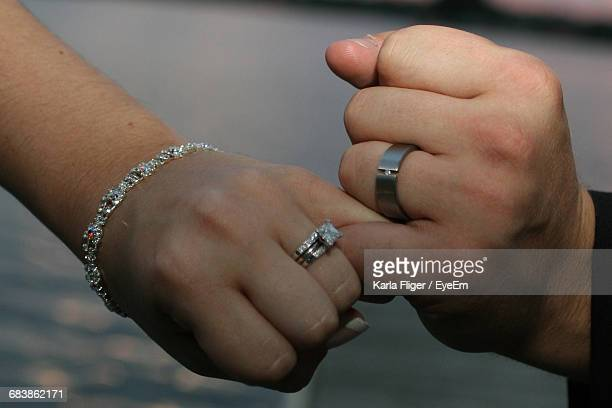 Close-Up Of Hands With Engagement Ring
