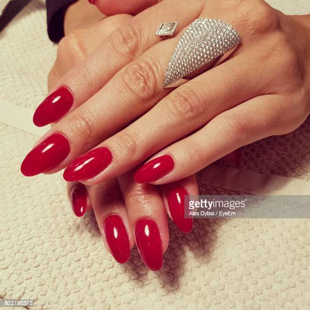 close-up of hands with red nail polish - red nail polish stock pictures, royalty-free photos & images