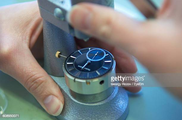 Close-Up Of Hands Working On Wristwatch