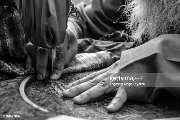 close-up of hands working - sewing stock pictures, royalty-free photos & images