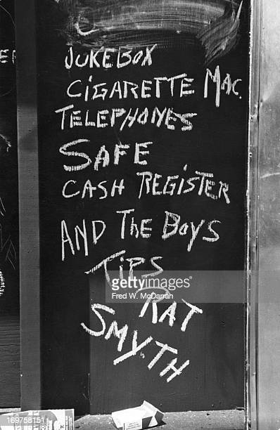 Closeup of handwritten chalk text on a boardedup window of the Stonewall Inn after riots over the weekend of June 27 1969 The text reads 'Jukebox...