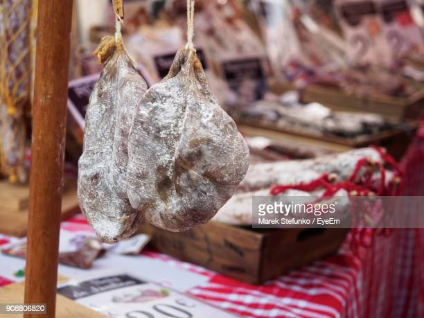 close-up of hanging meat at stall - marek stefunko - fotografias e filmes do acervo