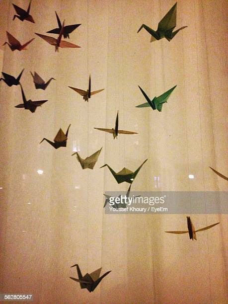 Close-Up Of Hanging Paper Birds