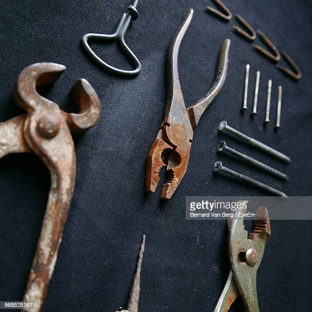 Close-Up Of Hanging Work Tools In Workshop