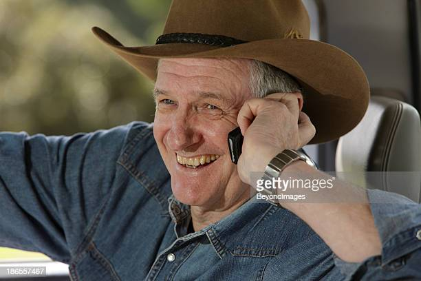 Close-up of happy farmer on mobile phone