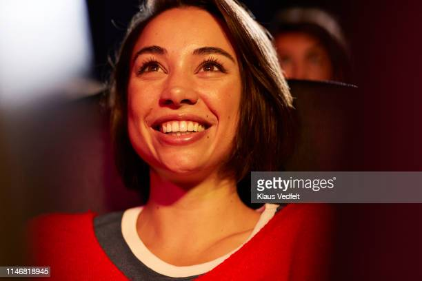 close-up of happy woman at theater - watch what happens: live stock pictures, royalty-free photos & images