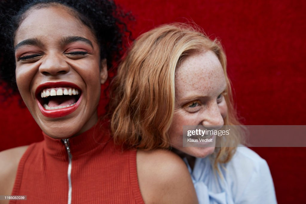 Close-up of happy young females standing outdoors : Stock Photo