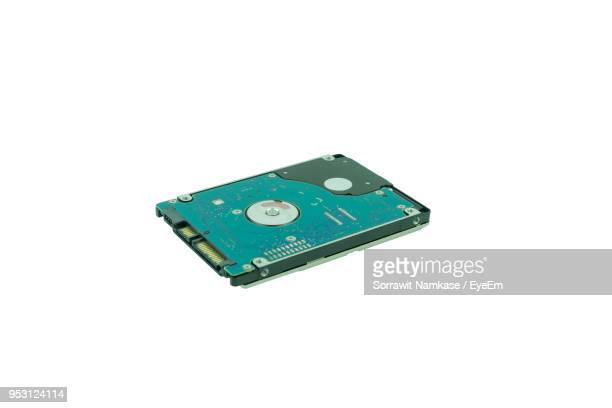 Close-Up Of Hard Drive Against White Background