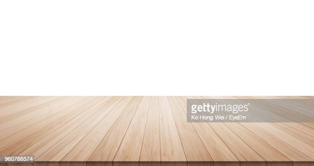 close-up of hardwood floor against wall - flooring stock photos and pictures