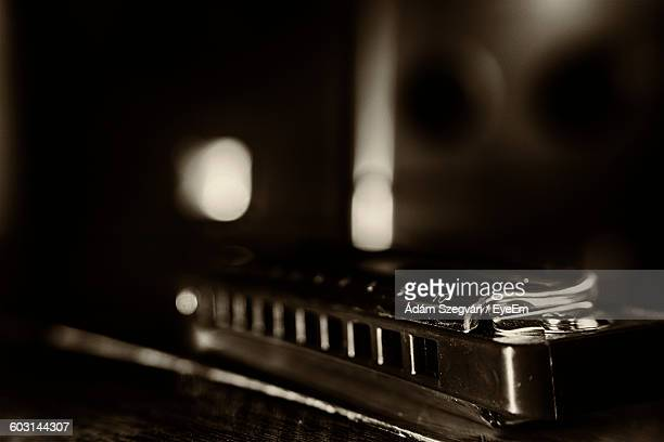 Close-Up Of Harmonica On Table