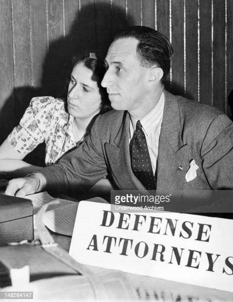 A closeup of Harry Bridges West Coast CIO leader and his daughter Jacqueline as they listen to proceedings in the Immigration Office on Angel Island...