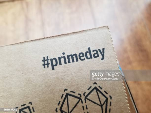 Close-up of hashtag advertisement for Amazon Prime Day, printed on Amazon delivery box, San Ramon, California, July 8, 2019.