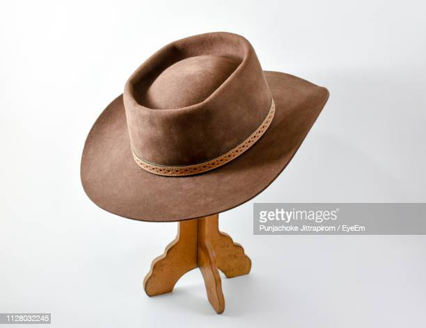close-up of hat against white background - cowboy hat stock pictures, royalty-free photos & images