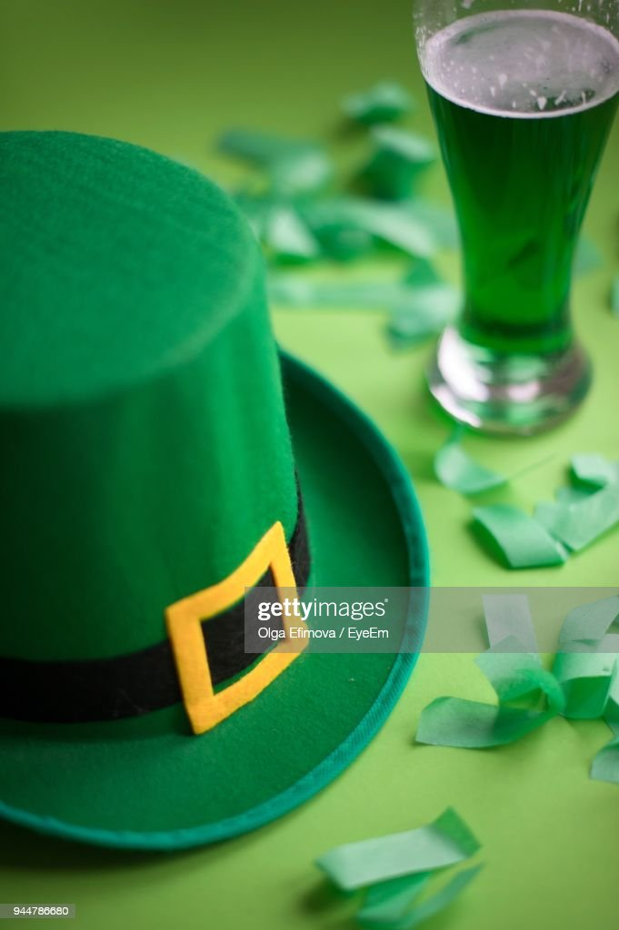 Close-Up Of Hat And Confetti On Table : Stock Photo