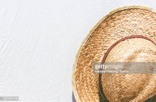 close-up of hat hanging on wall - straw hat stock pictures, royalty-free photos & images