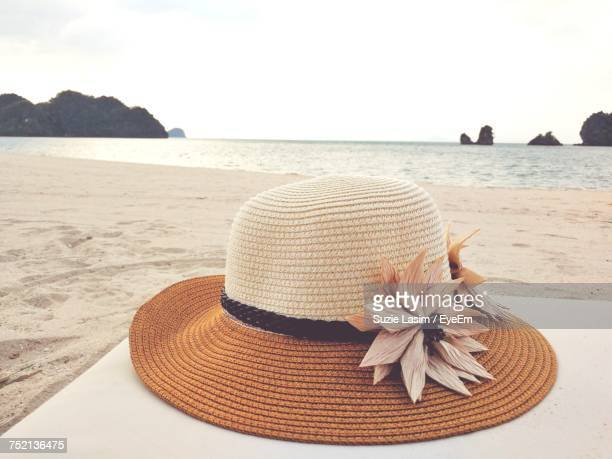 Close-Up Of Hat On Beach Against Sky