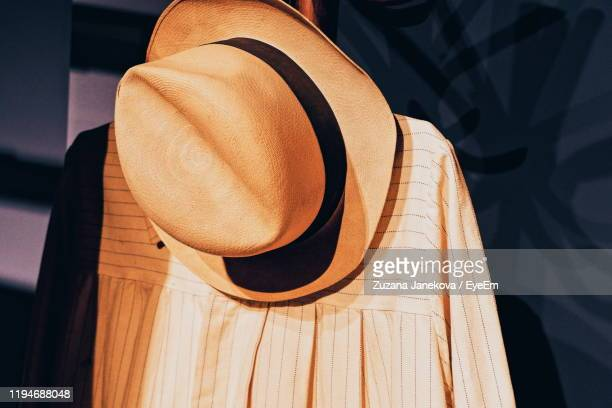 close-up of hat on clothes - zuzana janekova stock pictures, royalty-free photos & images