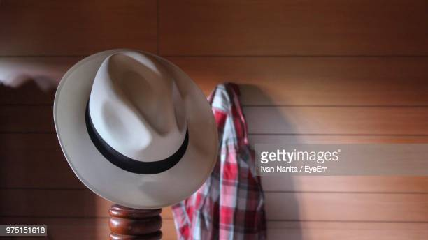 Close-Up Of Hat On Pole Against Wooden Wall