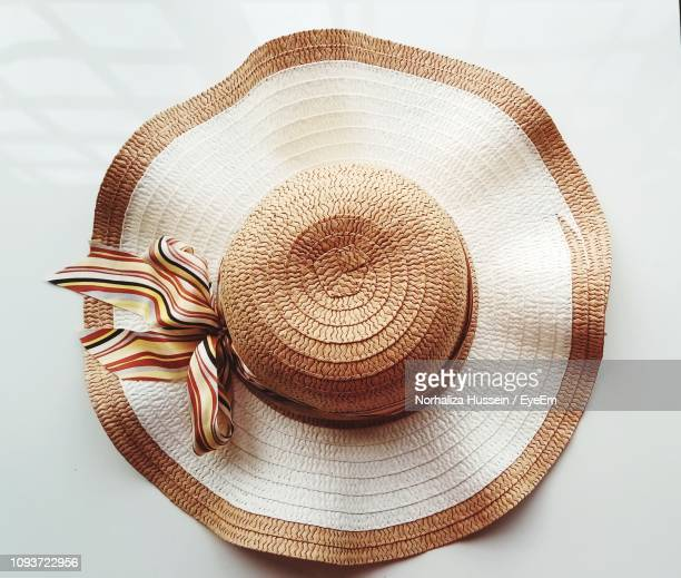 close-up of hat on table - sun hat stock pictures, royalty-free photos & images