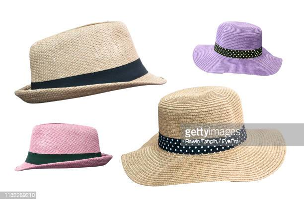 close-up of hats against white background - straw hat stock pictures, royalty-free photos & images