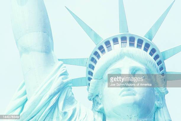Closeup of head and arm of the Statue of Liberty