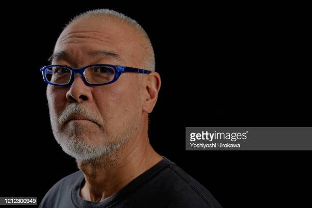 close-up of head portrait of mature man in 50s - three quarter front view stock pictures, royalty-free photos & images