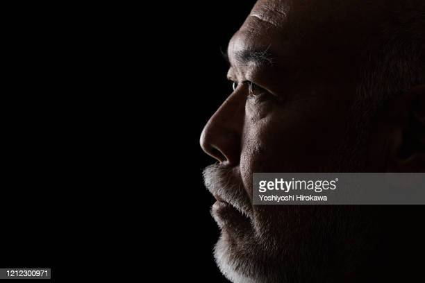 close-up of head portrait of mature man in 50s - in silhouette stock pictures, royalty-free photos & images