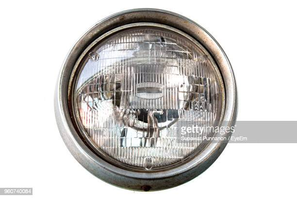 Close-Up Of Headlight Against White Background