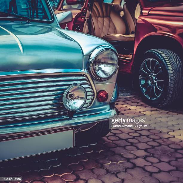 Close-Up Of Headlight Of Vintage Car On Paving Stone