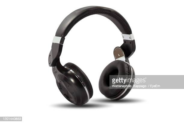 close-up of headphones against white background - headphones stock pictures, royalty-free photos & images