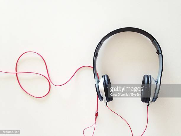 Close-Up Of Headphones Over White Background