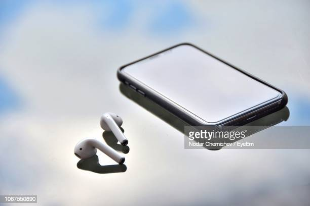 Close-Up Of Headphones With Smart Phone On Table