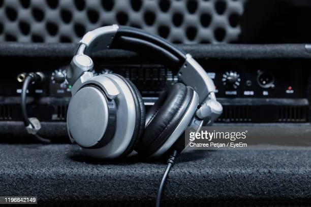 close-up of headphones with sound mixer - equaliser stock pictures, royalty-free photos & images