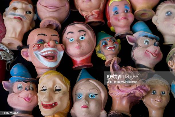 Close-up of heads of dolls