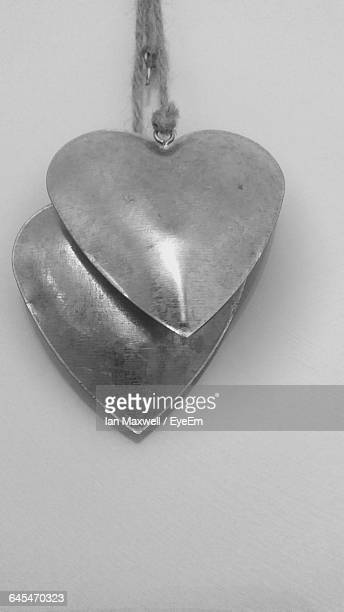 Close-Up Of Heart Pendant On String