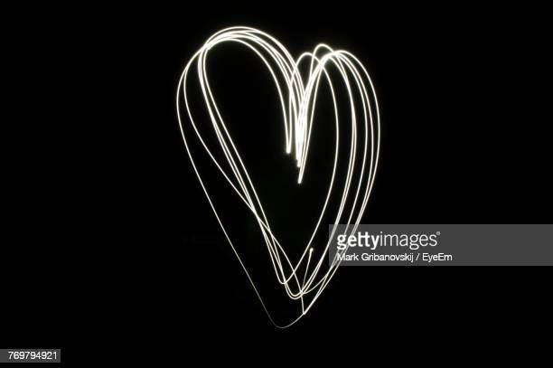 Close-Up Of Heart Shape Against Black Background